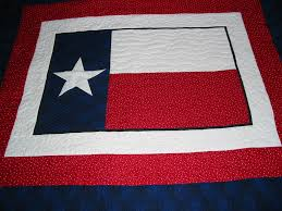 Texas Flag & This is a new quilt for Nancy. We call it our showcase quilt. It is an  arrangement of borders that frame a theme. In this case the Texas flag. Adamdwight.com