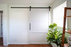 after how to hang a barn door in your home diy diy playbook
