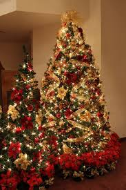 Red and gold Christmas tree with white lights. So spectacular. I love the  base