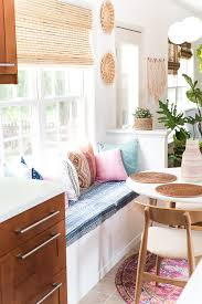 sarah at room for tuesday created a budget storage banquette from an ikea cabinet and it s perfect not only does it look like a built in it has storage