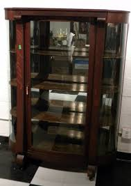 If yourself compass a large concurrence of items, the glass curio cabinet is what you covet. Empire Style Curved Glass Curio Cabinet Antique May 20 2011 Bloomington Auction Gallery Llc In Il