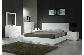white king size bed stylish modern white king size bedroom furniture sets ideas with brown gy rug and black accent bed lamp white faux leather king size