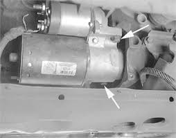 show a diagram of starter position in 1994 buick lasabre fixya the starter is attached to the engine 2 mounting bolts see arrows