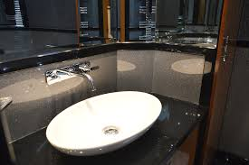 no bespoke vanity top and surrounding splash panels from versital cabinet hand made by langley interiors