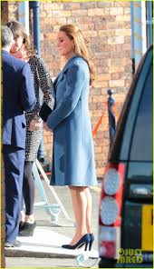 kate middleton covers baby p in royal blue peacoat