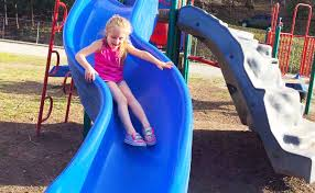 playing at the park on the playground for kids children w slides swings climbing and dinosaurs you