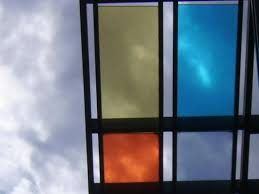 sunny day home office. The Home Office Building: Detail Of Coloured Glass Panels, With Sun Shining Through; Sunny Day U