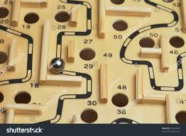 Wooden Maze Game With Ball Bearing Closeup Ball Bearing Navigating Wooden Maze Stock Photo 100 67