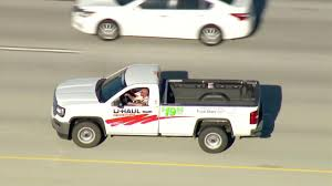 Armed suspect in U-Haul pickup truck shoots himself following chase ...