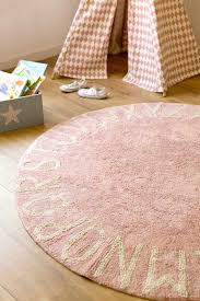 round pink rugs for nursery ethereal girl with baby