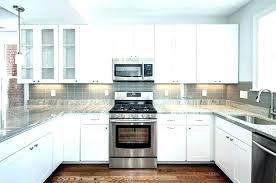white kitchen black countertops these beautiful granite counters