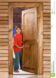 Boy at front door stock photo Image of open home door 2688016
