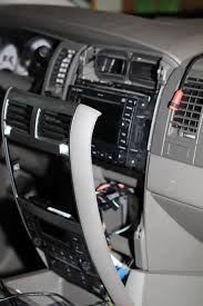 2007 dodge durango heater ac control instrument lights burned out from the bottom carefully pull the whole panel away from the dash there are three clips on each side and a tab at the top that holds the panel in