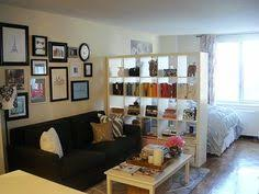small studio apartment living room ideas. nice idea for if i ever have a studio guest house or really big room. make your feel cozier :) could add curtain to bedroom side of the book small apartment living room ideas