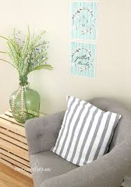 learn how to hang a poster without damaging your walls using painters tape and hot