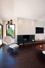 san francisco black marble fireplace surround with midcentury modern coffee tables family room and built ins