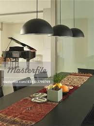 pendant lighting for dining table. Modern Black Dining Room Table With Pendant Lights - Stock Photo Lighting For