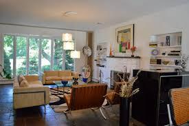 mid century modern living room ideas white paint color black porcelain flooring wooden end table grey