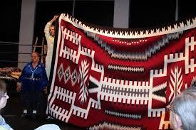 bessie yazzie with her 10x12 storm pattern rug
