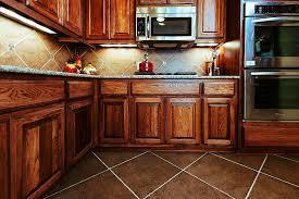 dark stained kitchen cabinets. Refinishing Stained Kitchen Cabinets Playmaxlgccom. Dark