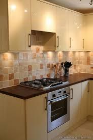 Kitchen Tile Backsplash Ideas:dark countertops with light stone backsplash