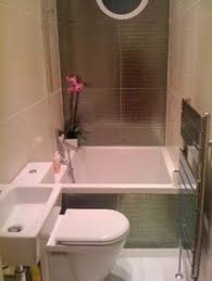 Small Bathroom- love the tub/ shower setup. The small sink bedside the  toilet
