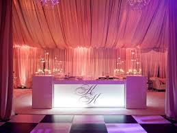 Black and white dance floor with custom wedding bar
