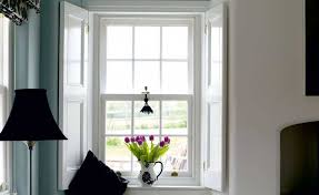 sash window with shutters in period home