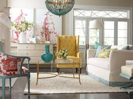 yellow and blue living room design with currey co alberto orb chandelier over brass and glass coffee table