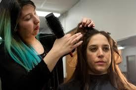 austin isd students say cosmetology program is more than just crockett high school senior jennifer ayala cuts kut reporter kate mcgee s hair jennifer is working