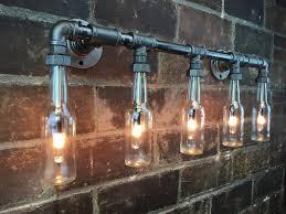 industrial pipe lighting. Industrial Vanity Light - Bottle Chandelier Steampunk Furniture Ed \u2013 Peared Creation Pipe Lighting