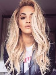 rita ora always proving how gorgeous blonde hair pairs with brown eyes love this