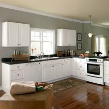 cool home depot kitchen design with crown molding and white kitchen cabinets with black granite countertop and laminate wood flooring