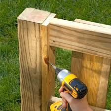 how to put up a wooden fence putting up a garden fence put up wooden privacy