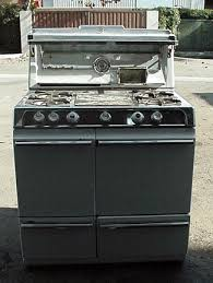 retro classic vintage antique gas stoves that are coming soon late 1950 s 36 o keefe merritt stove folding glass shelf clock timer 2 electric outlets cook light view down feature 4 burners left rear burner