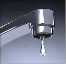 bathtub faucet dripping water