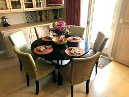 round dark wood dining table and 6 chairs fur