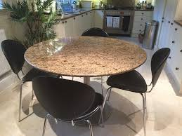 round granite table in venetian gold from heals and 6 italian leather chairs