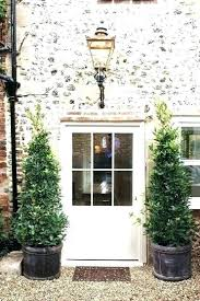 modest decoration front door topiary formal facade with black red brick and two trees artificial