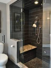 bathroom glass tile shower. shower seat and partial wall. marble, penny round floor bathroom glass tile o