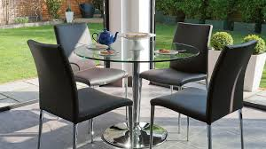 large round glass dining table and modern dining chairs
