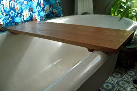 exciting soaking tubs with simple bathtub caddy and interior potted plant for modern bathroom design