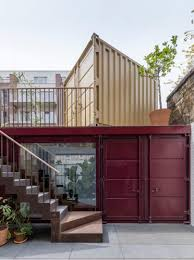 shipping containers office. UK Architect Simon Astridge Has Used Shipping Containers, Exposed Plasterwork And Clay Lighting To Create The Offices Showroom For A London Tile Containers Office
