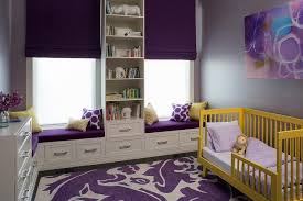 yellow and purple kids room with yellow convertible toddler crib