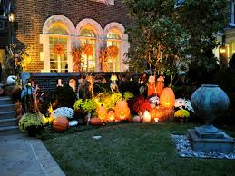 Fall Decorating Ideas With Scary Pumkins And Halloween Ornaments  Illuminated With Bright Spotlight