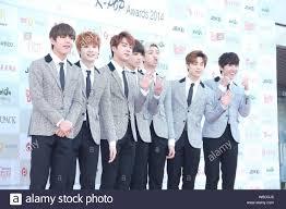 Gaon Chart Kpop Awards 2015 Members Of South Korean Pop Group Bangtan Boys Pose On The