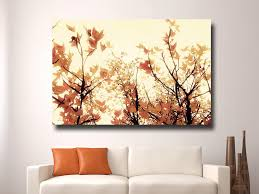amazing wall decor paintings of autumn leaves on small white modern sofa with cushions and some decoration objects compatible for the living room with white