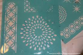 instructions  on diy stencil canvas wall art with using stencils to create art for your walls