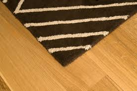 a rug sitting on a wood floor