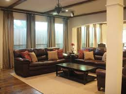 living room dark brown leather sofa with cushions plus rectangle black wooden table with shelf